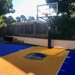 Backyard Basketball Court with Warriors Logo
