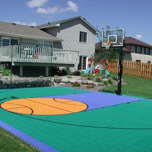 Backyard Basketball Court Sport Court Green and Blue with basketball logo